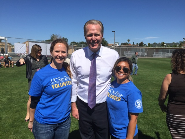 UC San Diego staff members Kate McDevitt and Kate Edra celebrate with Mayor Kevin Faulconer.