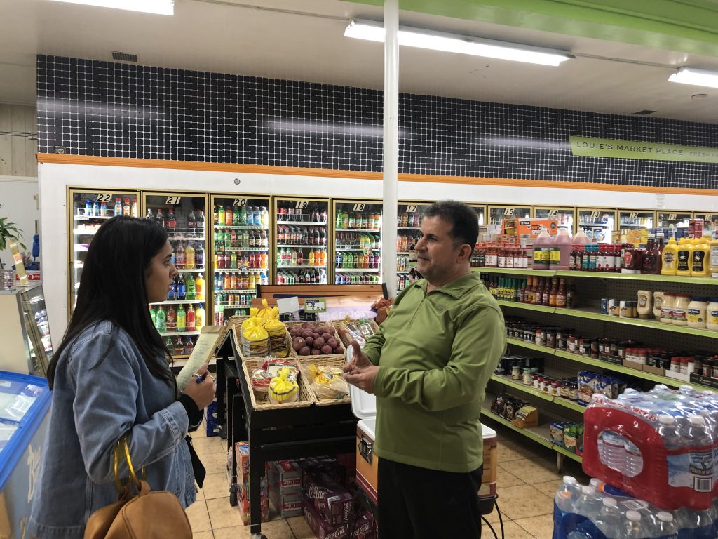 Louie's Market Place owner Latif Georges talking to Urban Food Environments staff Kate Mahoney