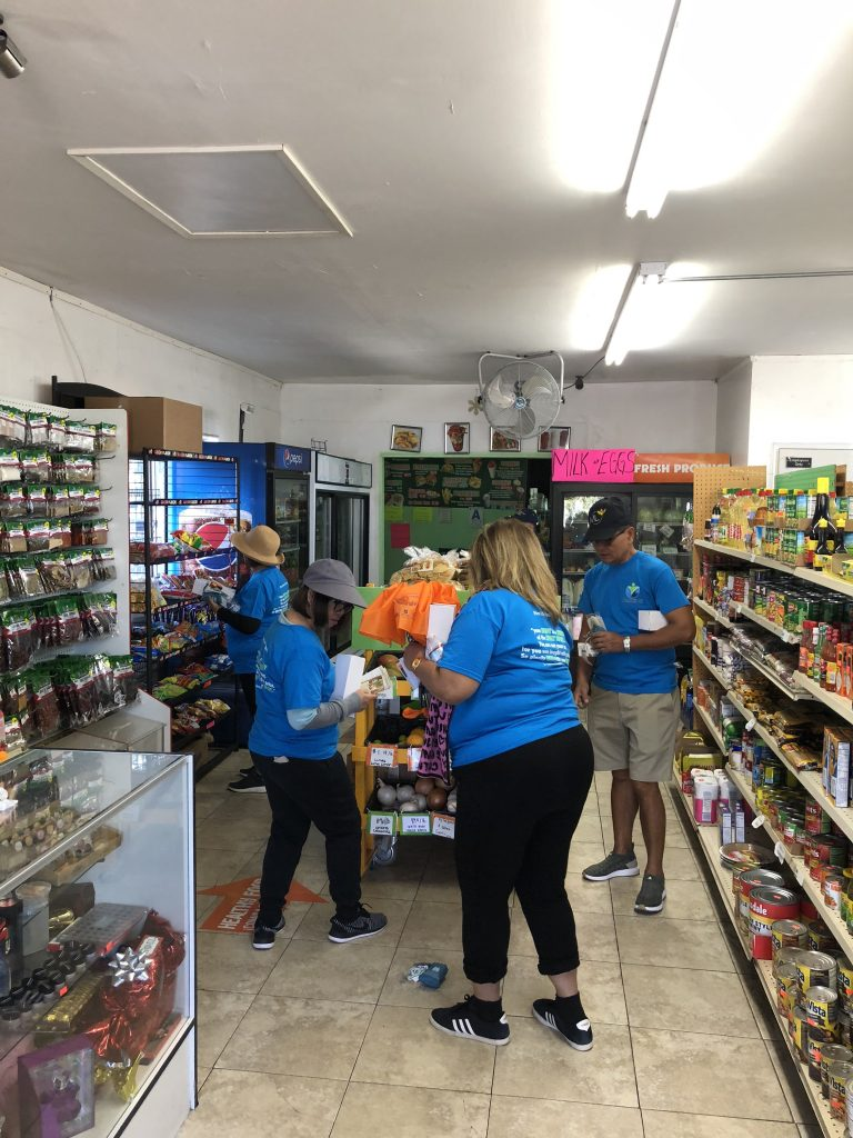 Shoppers from the local church checking out new product offerings at Munchies Corner Store